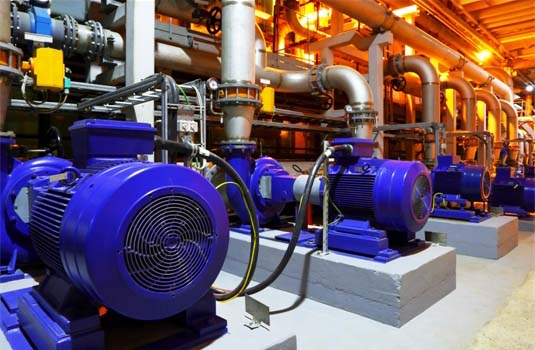 Industrial Electrical Motors Powering Pumps